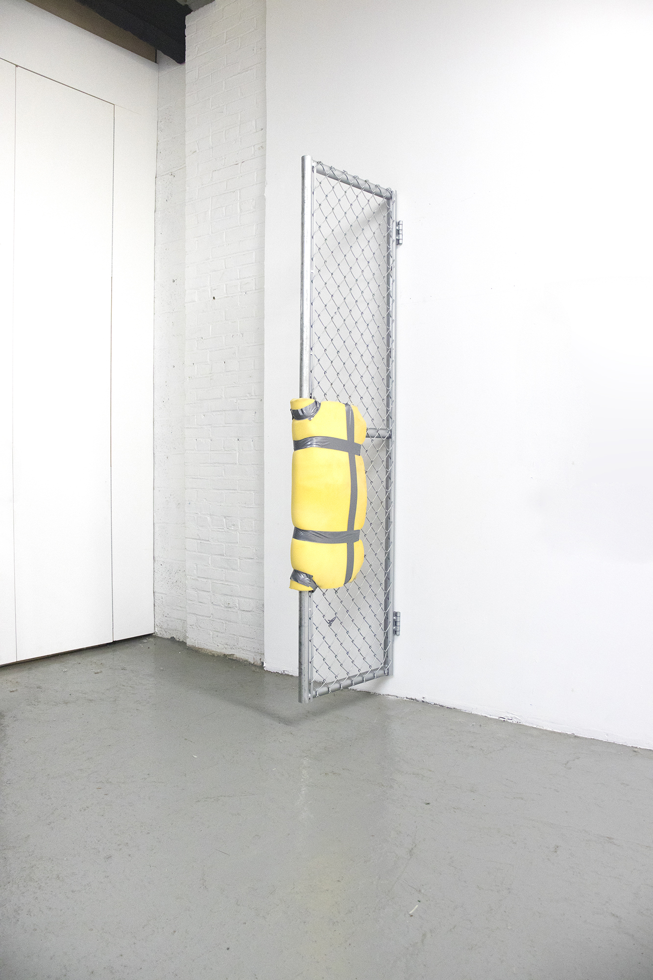 04_Rivlin_Bat-Ami_Untitled metal gate, yellow foam, duct tape_Found object sculpture_90x35x35
